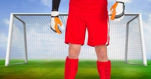 Soccer goalkeeper in goal. Digital composite of Soccer goalkeeper in goal royalty free stock photo