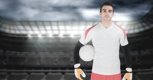 Soccer goalkeeper holding ball in goal. Digital composite of Soccer goalkeeper holding ball in goal Royalty Free Stock Photography
