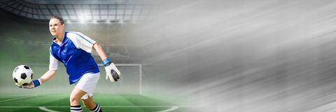 Soccer goalkeeper holding football in goal with transition stock photos