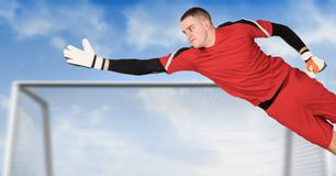 Soccer goalkeeper saving in goal. Digital composite of Soccer goalkeeper saving in goal stock photo