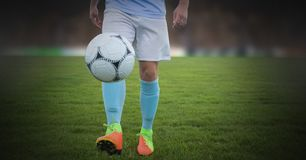 Soccer player on grass with football solo royalty free stock photography