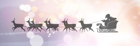 Sparkling lights transition of Santa`s sleigh and reindeer`s. Digital composite of Sparkling lights transition of Santa`s sleigh and reindeer`s Stock Photos