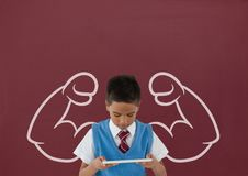 Student boy with fists graphic using a tablet against red blackboard Royalty Free Stock Photos