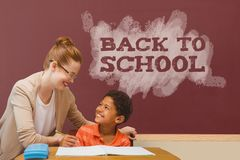 Student boy and teacher at table against red blackboard with back to school text. Digital composite of Student boy and teacher at table against red blackboard Royalty Free Stock Photos