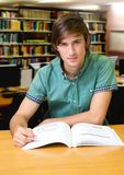 Student man in education library. Digital composite of Student man in education library royalty free stock photography