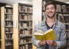 Student man in education library. Digital composite of Student man in education library royalty free stock image