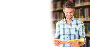 Student man in education library. Digital composite of Student man in education library royalty free stock photos