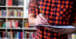 Student man in education library. Digital composite of Student man in education library stock image