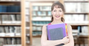 Student mature woman in education library. Digital composite of Student mature woman in education library royalty free stock photography
