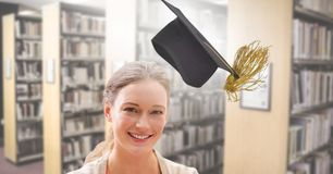 Student woman in education library with graduation hat. Digital composite of Student woman in education library with graduation hat royalty free stock image