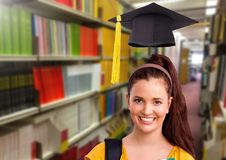 Student woman in education library with graduation hat. Digital composite of Student woman in education library with graduation hat stock image