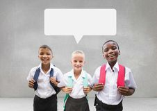 Students with speech bubble against grey background Stock Image