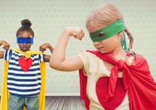 Superhero girl kids with blank room background royalty free stock image
