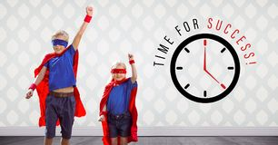 Superhero kids jumping in room with time for success clock graphic. Digital composite of Superhero kids jumping in room with time for success clock graphic stock image