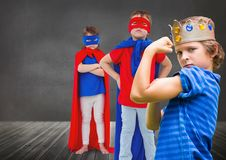 Superhero kids and king crown boy with blackboard background. Digital composite of Superhero kids and king crown boy with blackboard background Stock Images