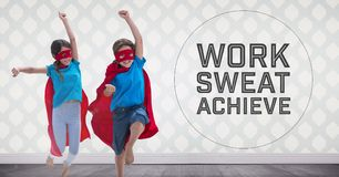 Superhero kids in room jumping with Work Sweat and Achieve text. Digital composite of Superhero kids in room jumping with Work Sweat and Achieve text stock image