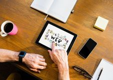 Table top with a tablet with web graphics on the screen Royalty Free Stock Photos