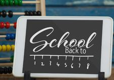 Tablet on a school table with back to school text on screen Stock Photo