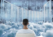Teenager sitting looking at simulation through clouds. Digital composite of Teenager sitting looking at simulation through clouds royalty free stock photos