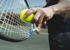 Tennis player holding racket on court with racket. Digital composite of Tennis player holding racket on court with racket Royalty Free Stock Image