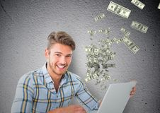 Texting money. happy man with laptop, money coming up from laptop. Digital composite of texting money. happy man with laptop, money coming up from laptop stock photography