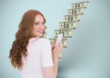 Texting money. Woman with phone in front of money stairs. Digital composite of texting money. Woman with phone in front of money stairs Stock Photo