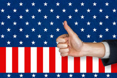 Digital composite of thumbs up Stock Image