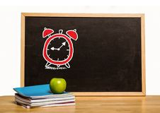 Time clock education drawing on blackboard for school. Digital composite of Time clock education drawing on blackboard for school royalty free stock photo