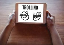 Trolling text and mouth cartoons on tablet in hands Stock Photos