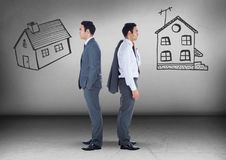 Two houses with Businessman looking in opposite directions Stock Photos
