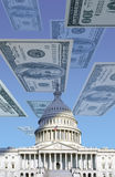 Digital composite: U.S. Capitol with floating one hundred dollar bills Stock Photos