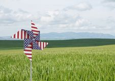 USA wind catcher in front of grass and sky Stock Images