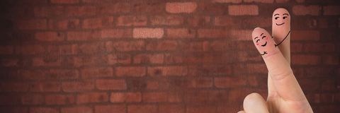 Valentine`s fingers love couple and brick wall. Digital composite of Valentine`s fingers love couple and brick wall Stock Images