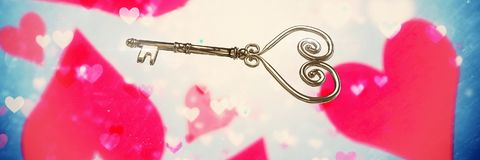 Valentines key and love hearts background. Digital composite of Valentines key and love hearts background Royalty Free Stock Photo