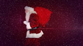 Video composition with falling snow over santa walking with sack on his back