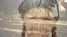 Falling autumn leaves and girl sneezing while suffering from allergy. Digital composite video of falling autumn leaves and girl sneezing while suffering from stock video