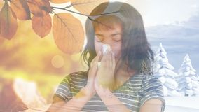 Woman sneezing while suffering from allergy against autumn leaves. Digital composite video of woman sneezing while suffering from allergy against autumn leaves stock footage
