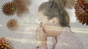 Woman suffering from sneezing and bacteria infection cells. Digital composite video of woman suffering from sneezing and bacteria infection cells 4k stock footage