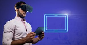 Virtual Reality Headset on man holding tablet with electric tablet rectangular icon. Digital composite of Virtual Reality Headset on man holding tablet with Stock Image
