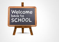 Welcome back to school text on blackboard Stock Image