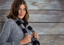 Woman against wood with warm scarf and jumper Royalty Free Stock Photography