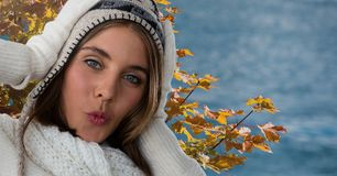 Woman in Autumn with hat and hood with tree leaves. Digital composite of Woman in Autumn with hat and hood with tree leaves royalty free stock photo
