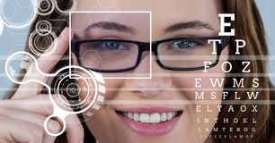 Woman with eye focus box detail over glasses and lines and Eye test interface. Digital composite of Woman with eye focus box detail over glasses and lines and royalty free stock photography