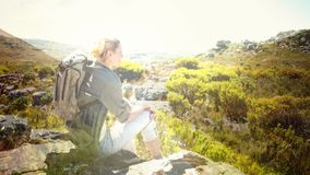 Woman hiking with nature transition. Digital composite of Woman hiking with nature transition stock video footage