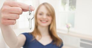 Woman Holding key in home. Digital composite of Woman Holding key in home Royalty Free Stock Photography