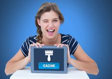 Woman holding tablet with Cache button and clean brush icon Royalty Free Stock Images