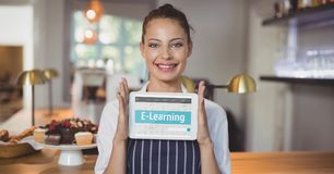 Woman holding a tablet with e-learning information in the screen. Digital composite of Woman holding a tablet with e-learning information in the screen Royalty Free Stock Photography