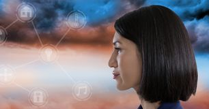 Woman looking at interface in clouds. Digital composite of Woman looking at interface in clouds Royalty Free Stock Images