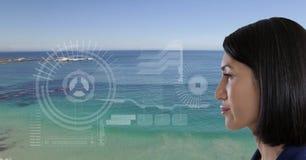 Woman looking at interface screen near sea. Digital composite of Woman looking at interface screen near sea Royalty Free Stock Photos