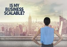 Woman looking out over city skyline with text in corner. Digital composite of Woman looking out over city skyline with text in corner Stock Photography
